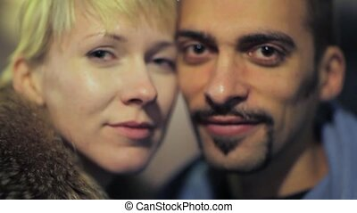 portrait of man with woman, camera moving forward and back
