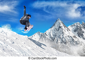 Extreme snowboarding man - Snowboarder jumping high in the...