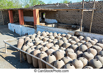 Clay Pisco Jars - Large clay jars used in the production of...