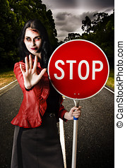 Zombie girl holding stop sign at dead end - Zombie...