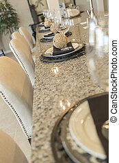 Abstract of Kitchen Counter Place Settings and Chairs -...