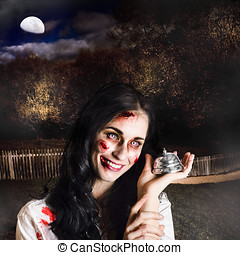 Spooky girl with silver service bell in graveyard - Creepy...