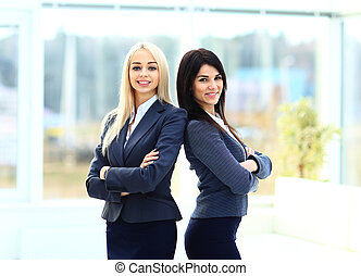 Two business women team at office