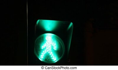pedestrian traffic light showing green, red in the night