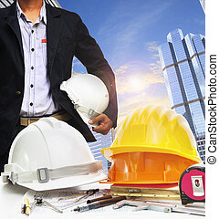 engineer working table against sky scrapper in urban scene use for land development and architecture occupation theme