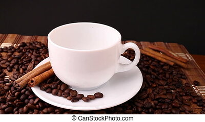 Pouring coffee into white cup