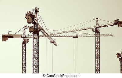 Construction cranes silhouettes - Construction cranes...