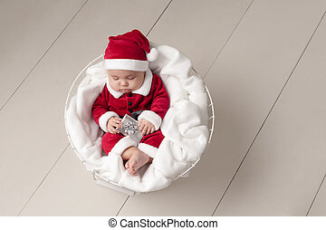 Baby Wearing a Santa Suit - Three Month old baby girl...