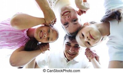 family with two little girls keeps for hands and then disperses