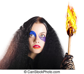 Staring woman holding flame torch - Bizarre woman with...