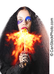 Woman breathing fire from mouth - Scary woman with long...