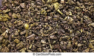 Green tea leaves close up rotation