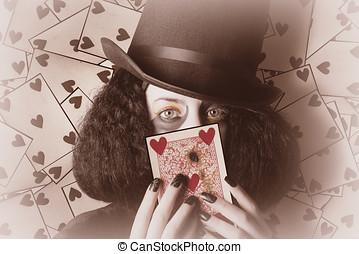 Retro magician holding burnt playing card - Beautiful retro...