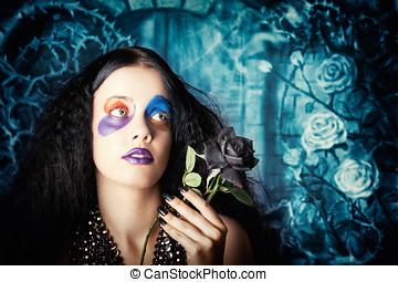 Gothic girl holding black rose Death and mourning - Gothic...