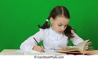 Emotional little girl tears spoiled paper. Child doing...