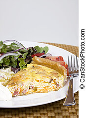 Quiche and salad - Quiche Lorraine with fresh salad on a...