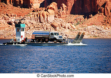 Barge Hauls Fuel - Tugboat transports barge loaded with a...