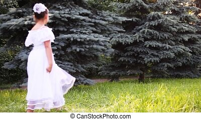 girl in white dress walk on grass