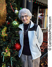Aginst a Christmas Tree Downtown - Grandmother, with white...