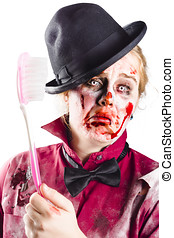 Diseased woman with big toothbrush - Bloody, beaten and...