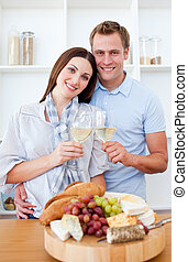 Enamoured couple drinking wine while cooking