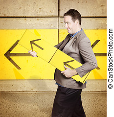 Businessman with arrow sign signalling growth - Business man...