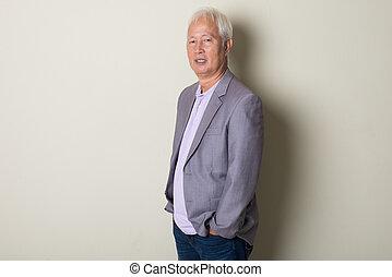 asian senior in a coat