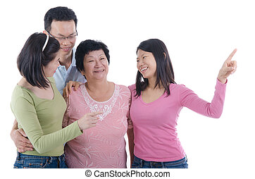 asian family pointing to somewhere