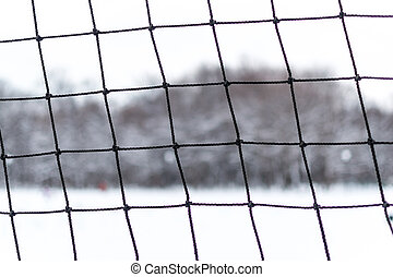 Closeup of Frayed Sports Netting in Winter - Frayed sports...