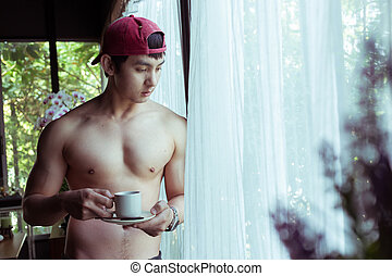 handsome man drink a coffee in the morning, male healthy...