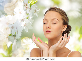 young woman face and hands - beauty, people, skincare,...