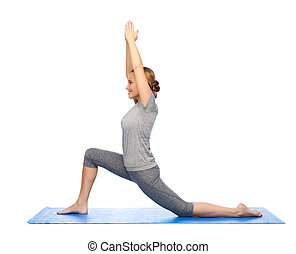 happy woman making yoga in low lunge on mat - fitness,...