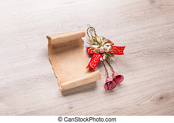 Christmas card on wooden table with christmas bell