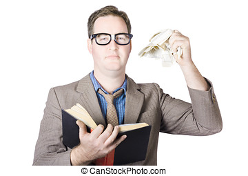 Businessman Tearing Pages From Book - Mature Businessman...