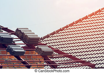 black tile roof on residential building construction house