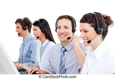 Multi-ethnic customer service agents working in a call...