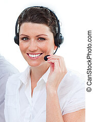 Charming businesswoman using a headphones against a white...