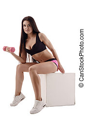 Attractive sportswoman exercising with dumbbells