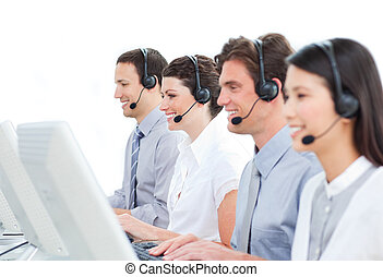 Self-assured customer service agents working in a call...