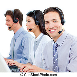 Ambitious customer service agents working in a call center...