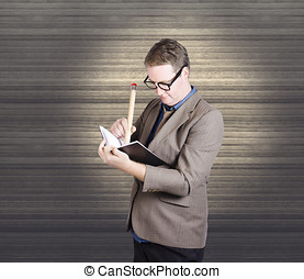 Male administration clerk writing diary notes - Male...
