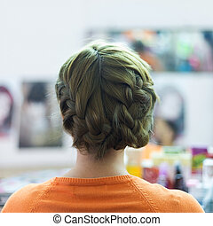 woman long braid hair creative styling bride hairstyle in beauty salon