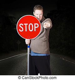 Business man holding road stop sign - Disruptive business...