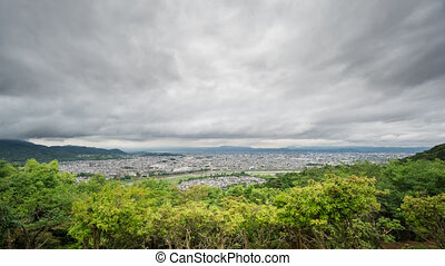 Time Lapse of Kyoto city with dark clouds, Japan - Wide...
