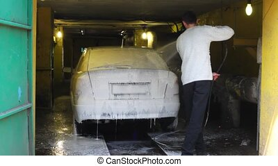 man washes the car