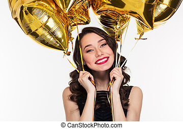 Cheerful happy beautiful woman in retro style holding golden...