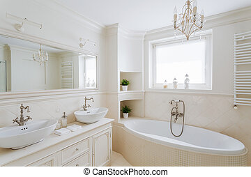 Showy bathroom in cream colors - Horizontal picture of a...