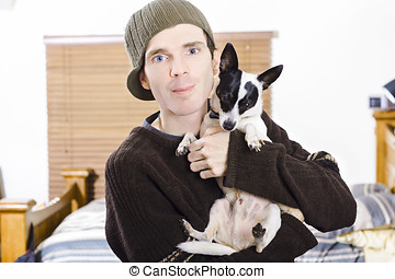 Young man with his little boy dog - House interior family...
