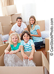 Smiling family packing boxes