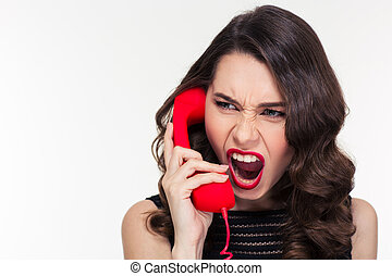 Angry woman in retro style screaming and talking on...